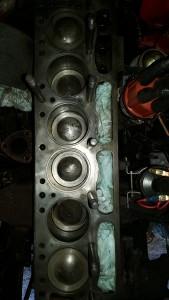 Head removed and prep work for the top end rebuild of a Triumph 6 cylinder engine